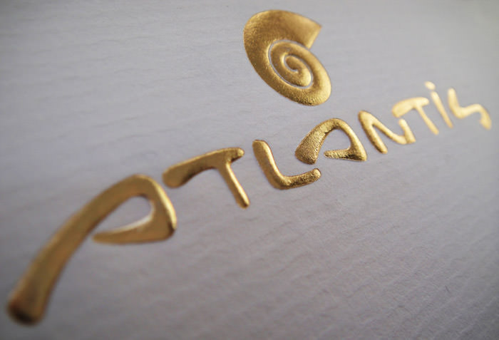 """Atlantis"" embossed logo on letterhead"
