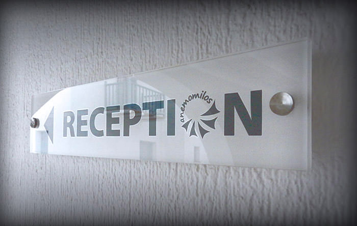 """Anemomilos"" exterior sign. Materials used: Plexiglass & vinyl sticker."