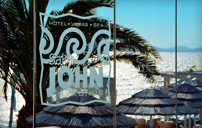 """Saint John Mykonos"" logo on a glass partition"