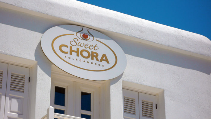 """Sweet Chora"" Exterior sign Materials used: laminate wood & plexiglass - Size: 130 x 80 cm"
